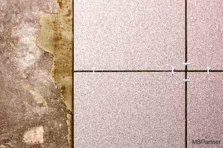 97806045-fragment-of-the-ndtfloor-in-the-process-of-laying-ceramic-tiles-close-up-